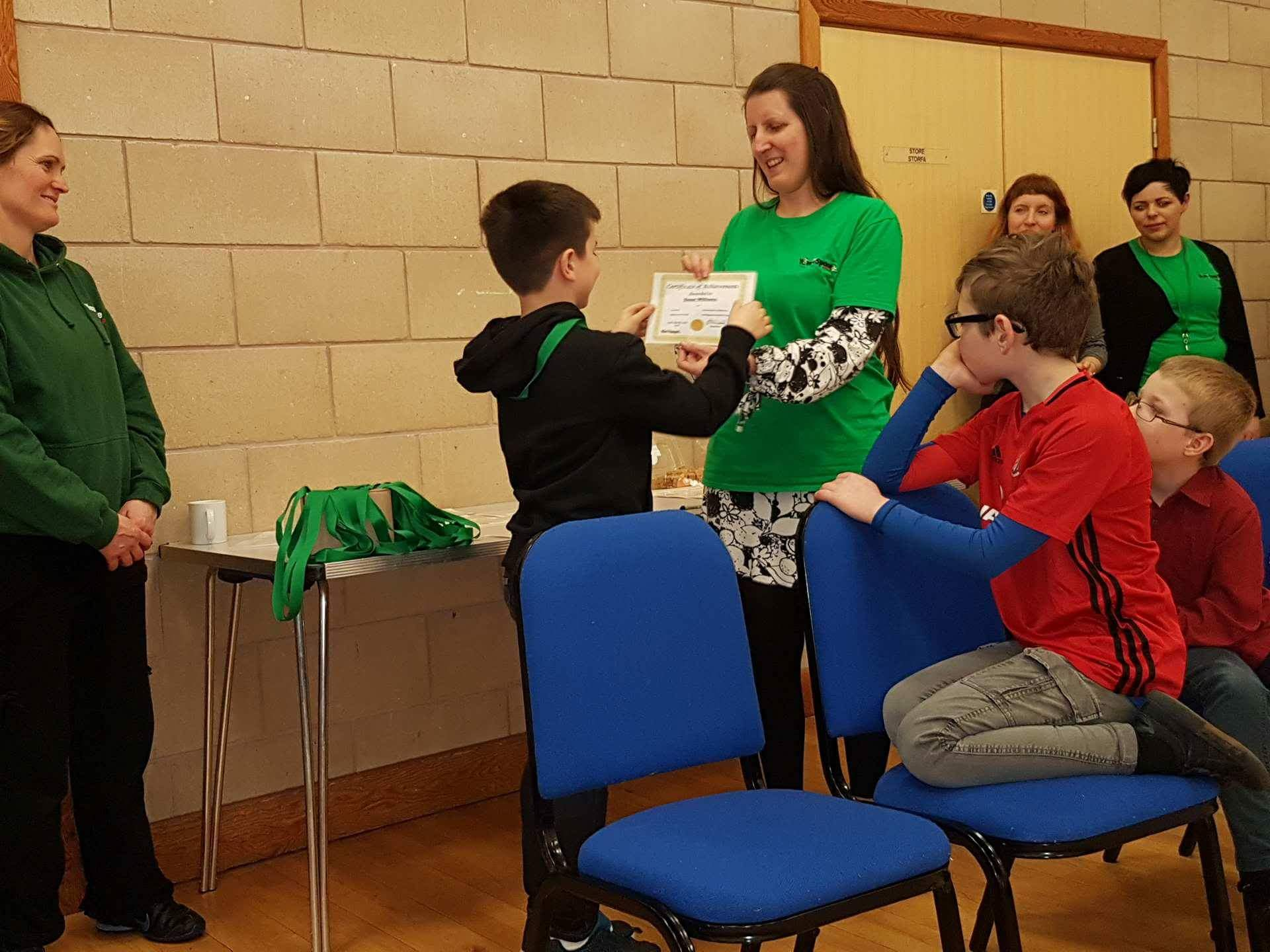 A boy receives his certificate